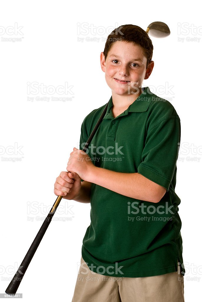 Young boy holding a golf club stock photo