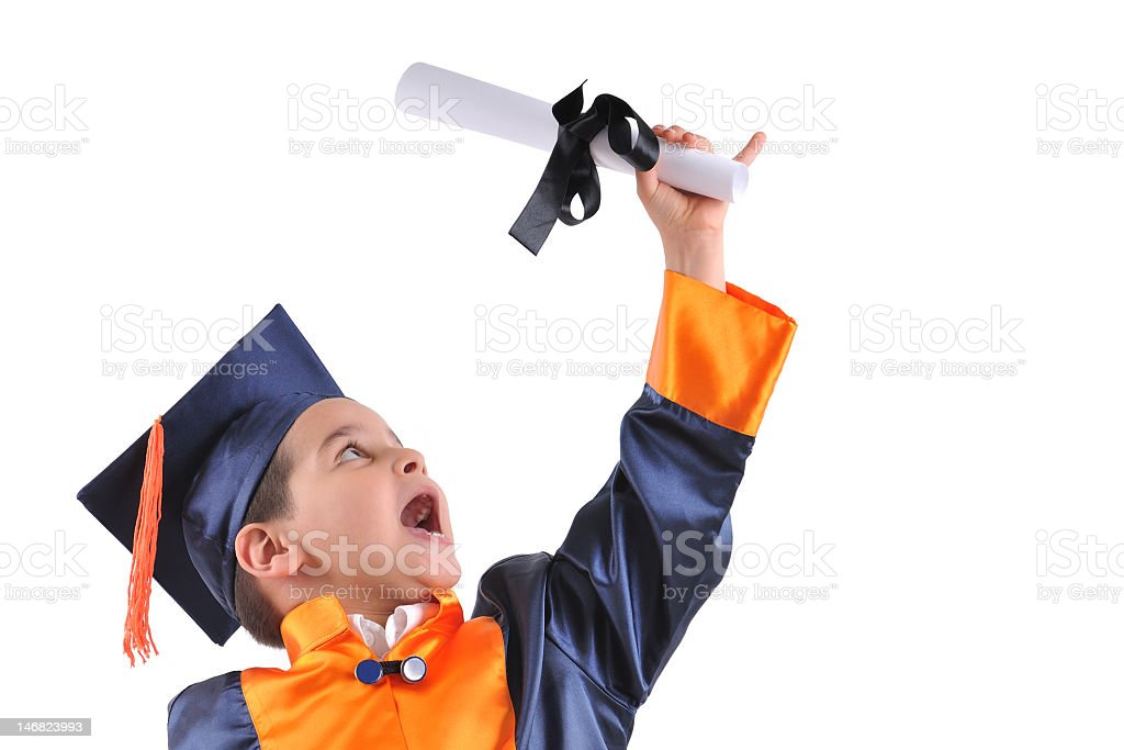 Young Boy Holding Diploma Wearing Cap And Gown Stock Photo & More ...