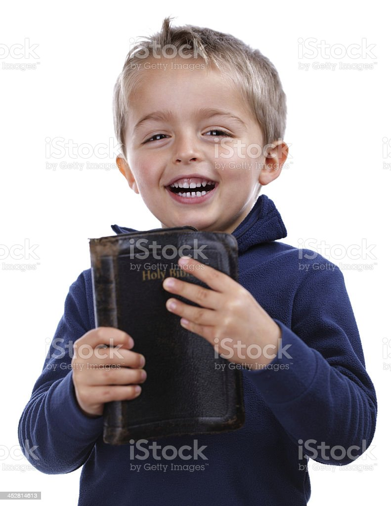 Young boy holding leather bound bible stock photo