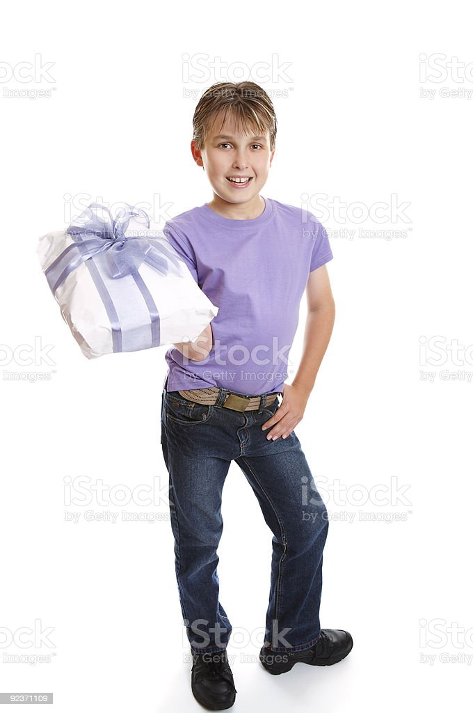 Young boy holding present royalty-free stock photo