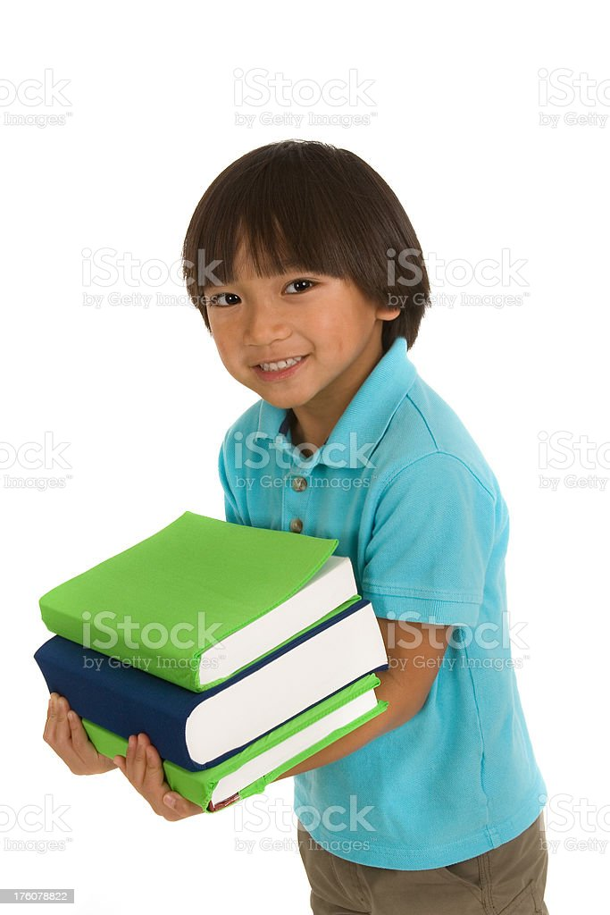 Young boy holding school books royalty-free stock photo