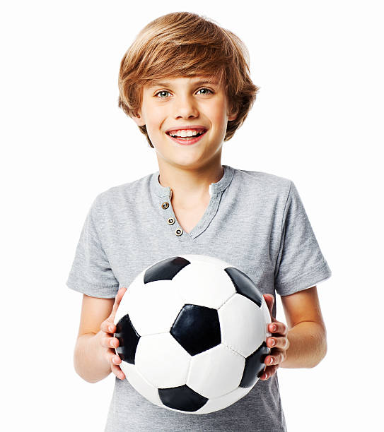 Young boy holding soccer ball stock photo