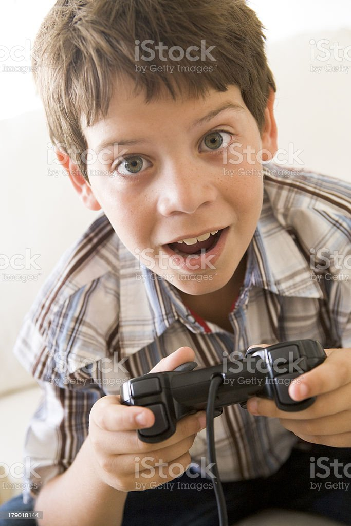 Young boy holding video game controller royalty-free stock photo
