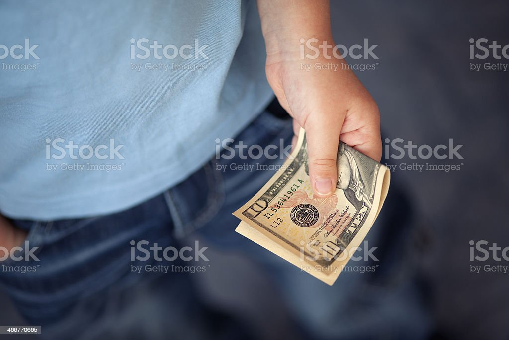 Young boy holds money stock photo