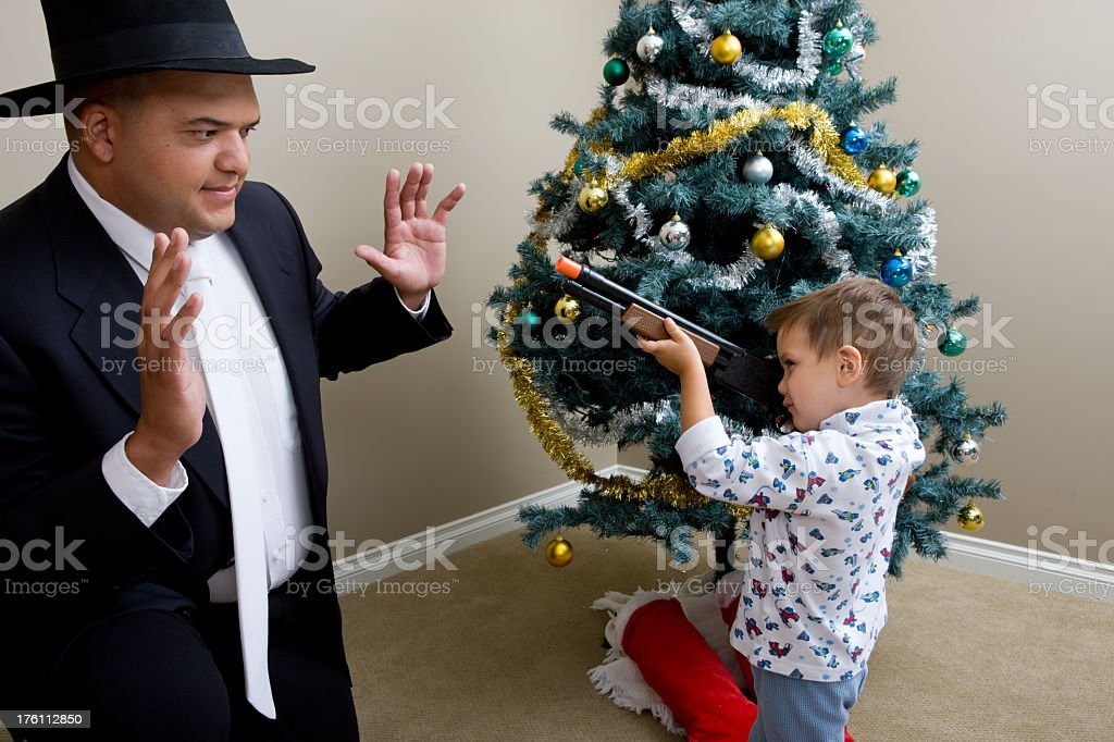 Young Boy Holds Up Amish Man Stealing Presents stock photo