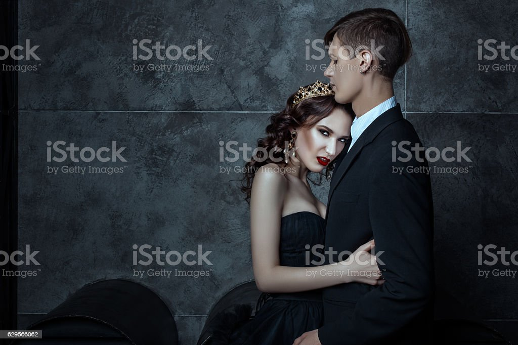 Young boy hugging the queen. stock photo