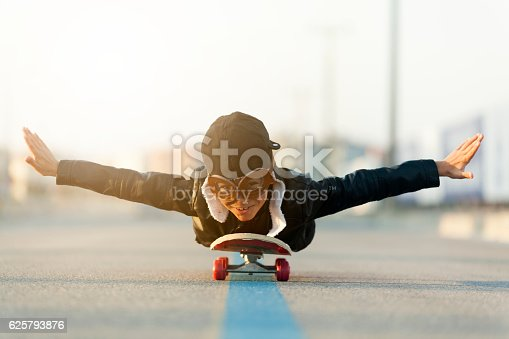 istock Young Boy Imagines Flying On Skateboard 625793876