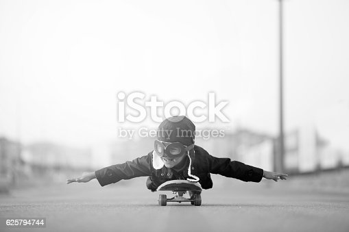 istock Young Boy Imagines Flying On Skateboard 625794744