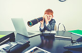 istock Young boy in a business suit with telescope. 1251408963