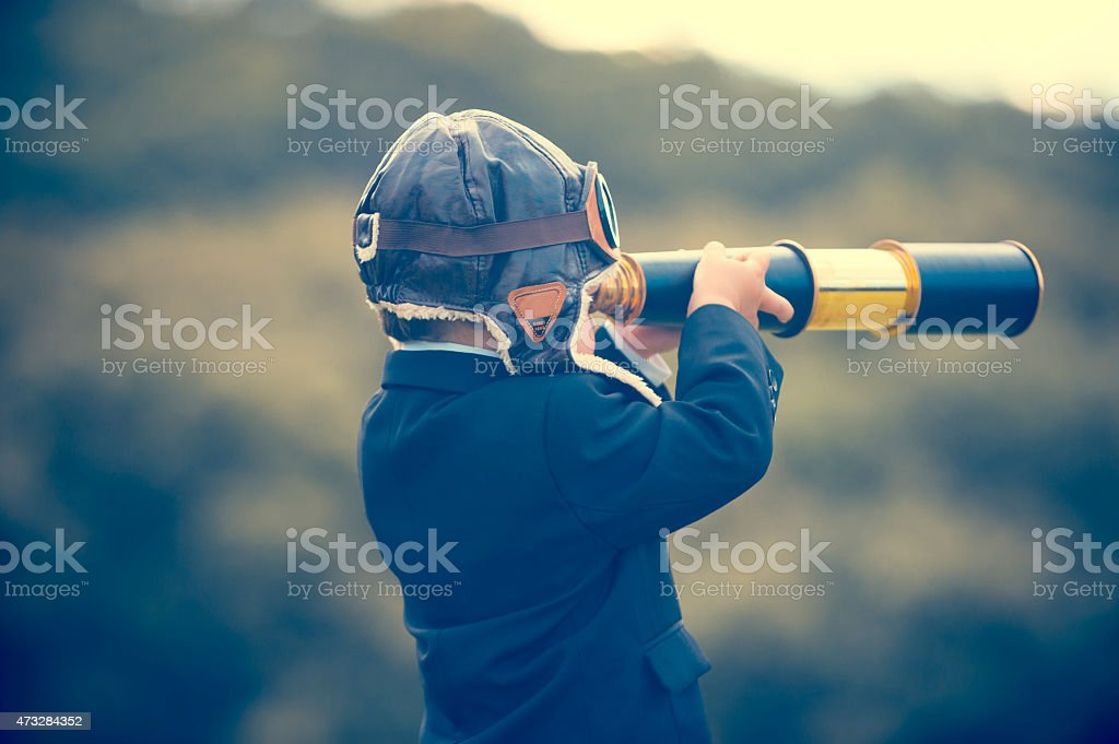 Young boy in a business suit with telescope. royalty-free stock photo