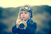 istock Young boy in a business suit with telescope. 473284374