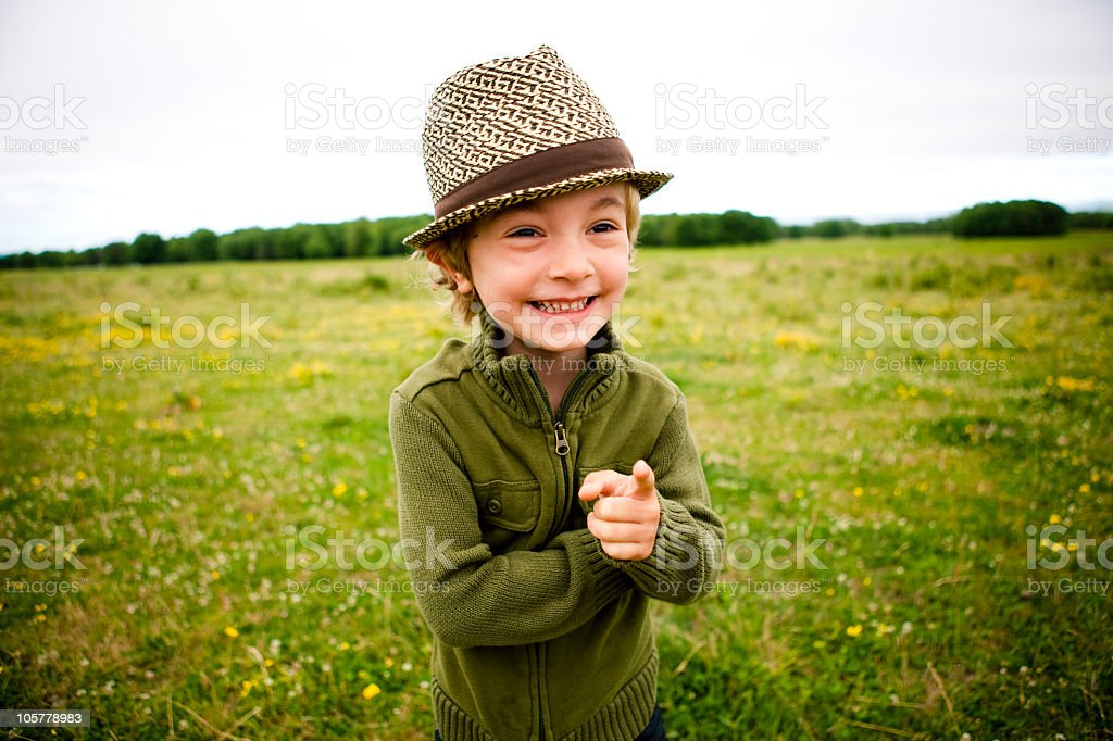 Young boy in a field royalty-free stock photo