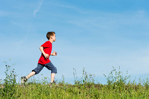 young-boy-in-a-red-tshirt-running-on-green-grass-picture-id175454446?k=6&m=175454446&s=612x612&w=0&h=9Fd8uH1frqNUhLaK1Pq7oI5iPkW1jSLeo74bKr8L2nY=