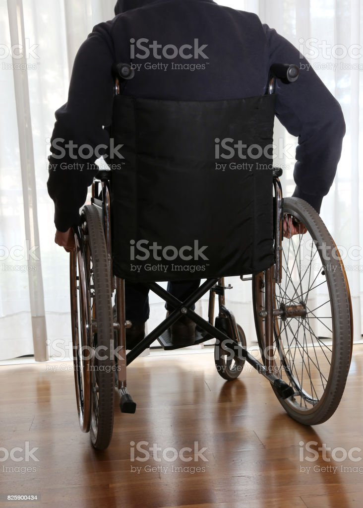 young boy in a wheelchair in the room of the clinic for rehabili stock photo