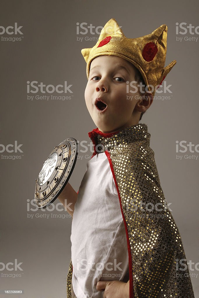 Young boy in costume of a king with crown stock photo