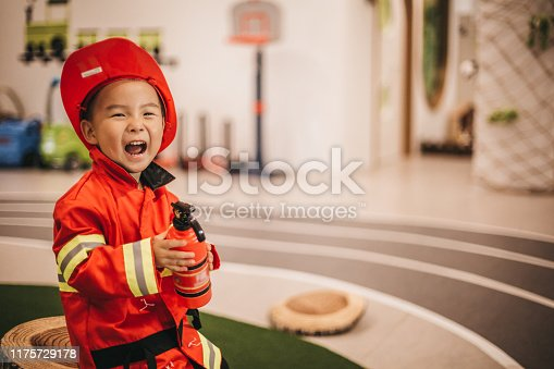 Young boy in fireman costume