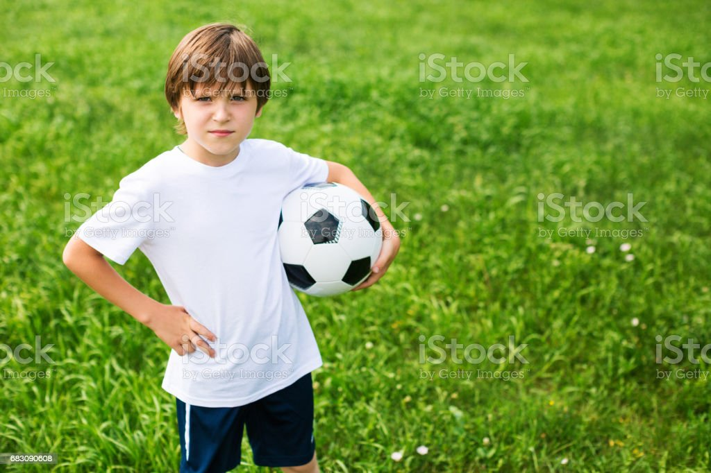 Young Boy In Football Team. foto de stock royalty-free