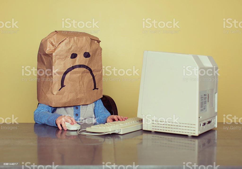 Young Boy in Front of Computer is Cyber Bullying Victim stock photo