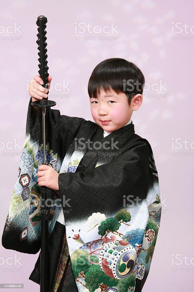 Young boy in Kimono stock photo