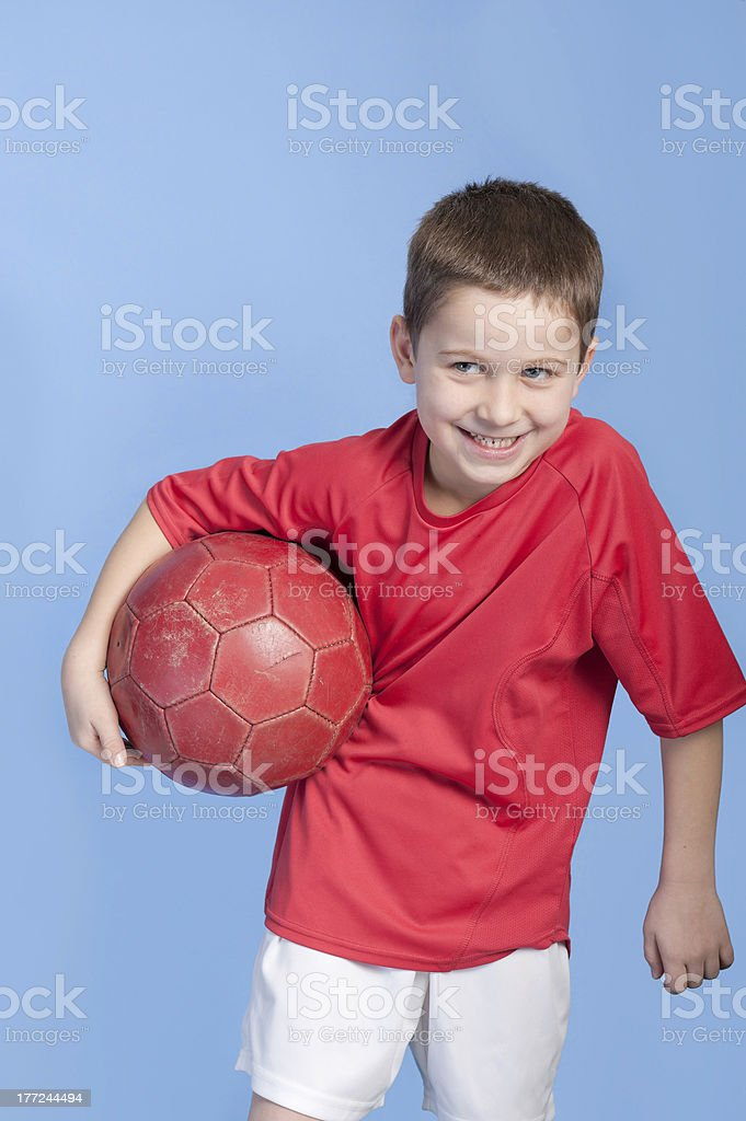 young boy in outfit with soccer ball royalty-free stock photo