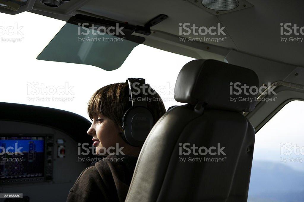 Young boy in the cockpit of a small seaplane. royaltyfri bildbanksbilder