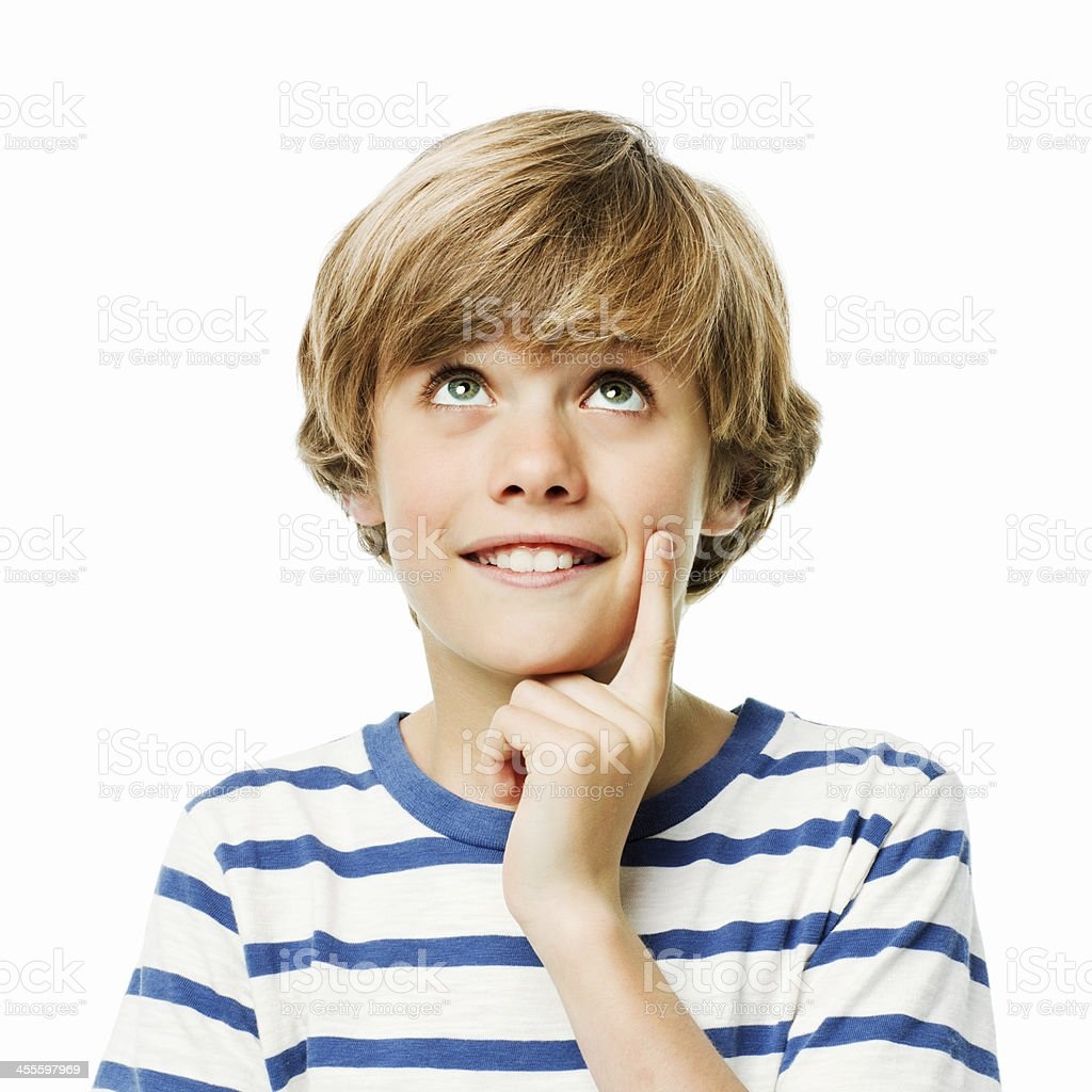 Young Boy in Thought - Isolated stock photo
