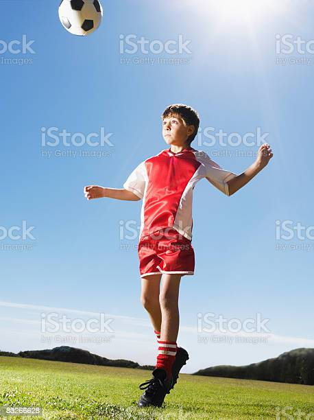 Young boy in uniform heading soccer ball picture id83266628?b=1&k=6&m=83266628&s=612x612&h=0c8timo6k5fwyq gzryctvrejtrausnpzwc 4hy60vg=