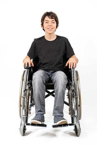 Young Boy in wheelchair stock photo