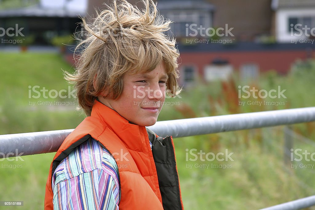Young boy in windy field royalty-free stock photo