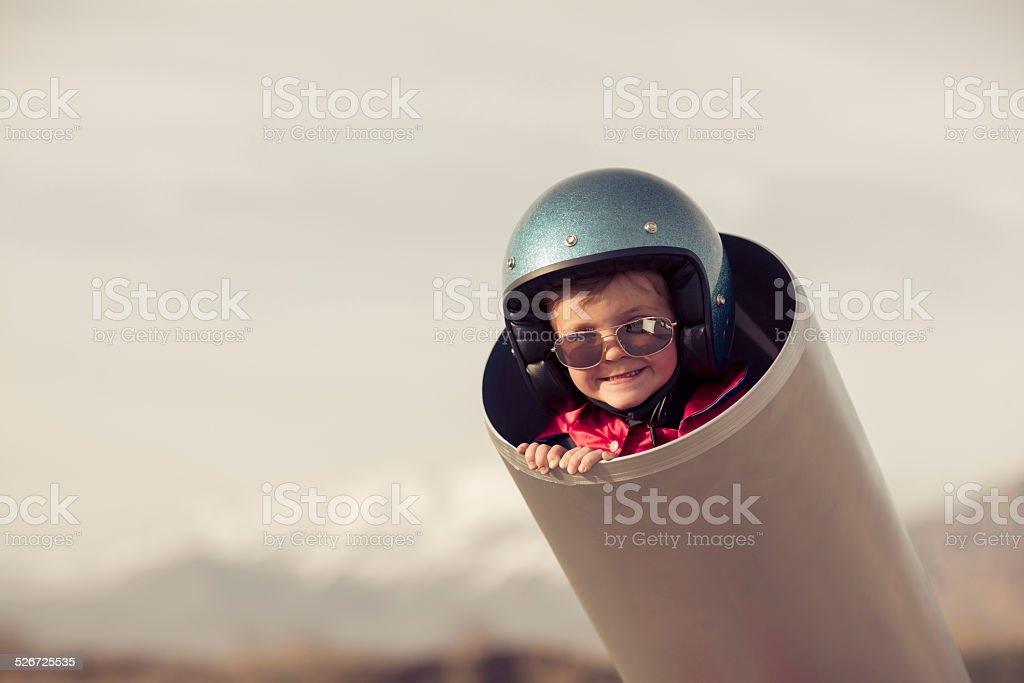 Young Boy is Human Cannonball in Cannon A young boy is ready to go places, real quick, with the help of a human cannon. Boom.  4-5 Years Stock Photo