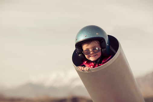 Young Boy Is Human Cannonball In Cannon Stock Photo - Download Image Now