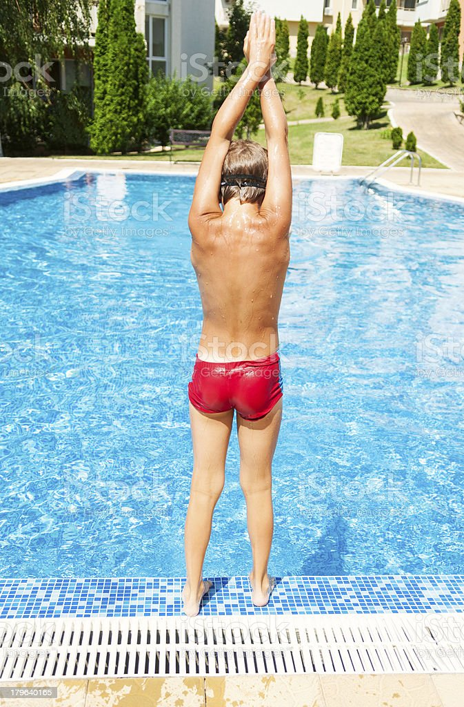 Young boy is ready for dive royalty-free stock photo