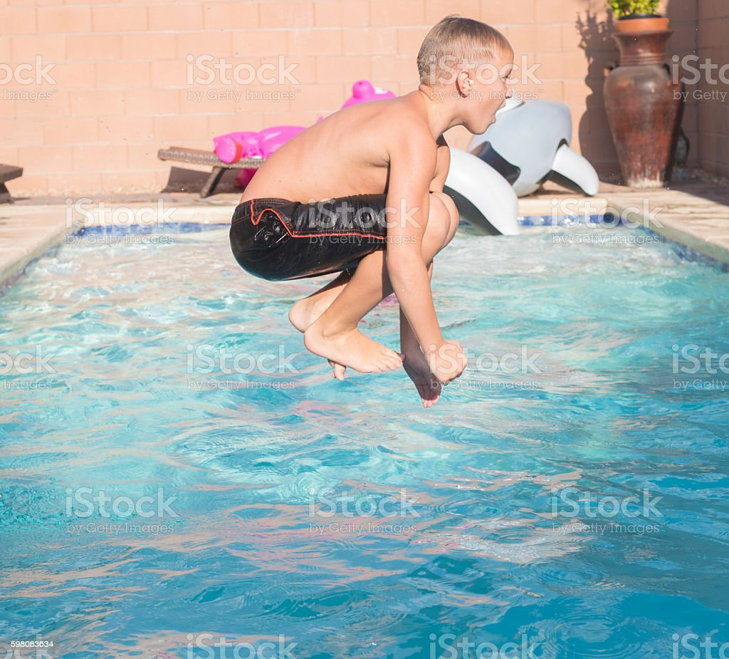 Young Boy Jumping in a swimming pool – Foto