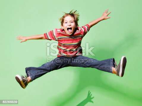 istock Young boy jumping in mid-air 83266639