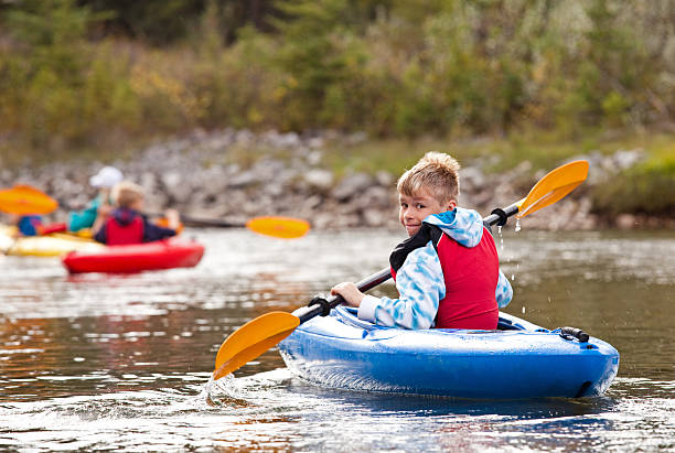Young Boy Kayaking stock photo