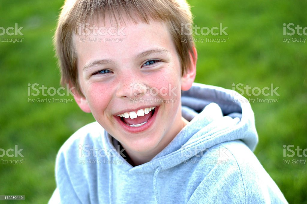 Young Boy Laughing with a Huge Smile Outside royalty-free stock photo