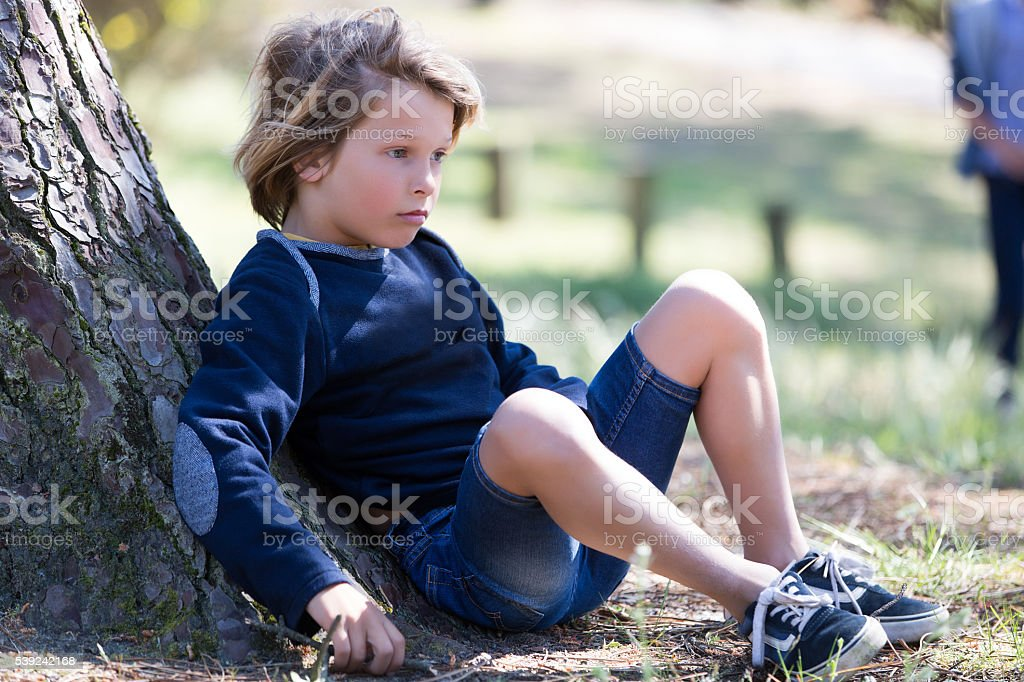 Young boy laying out in park royalty-free stock photo
