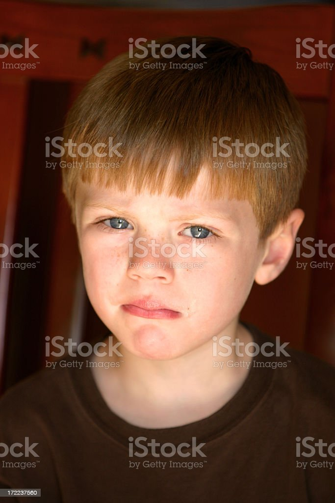 A young boy looking angrily at the camera royalty-free stock photo