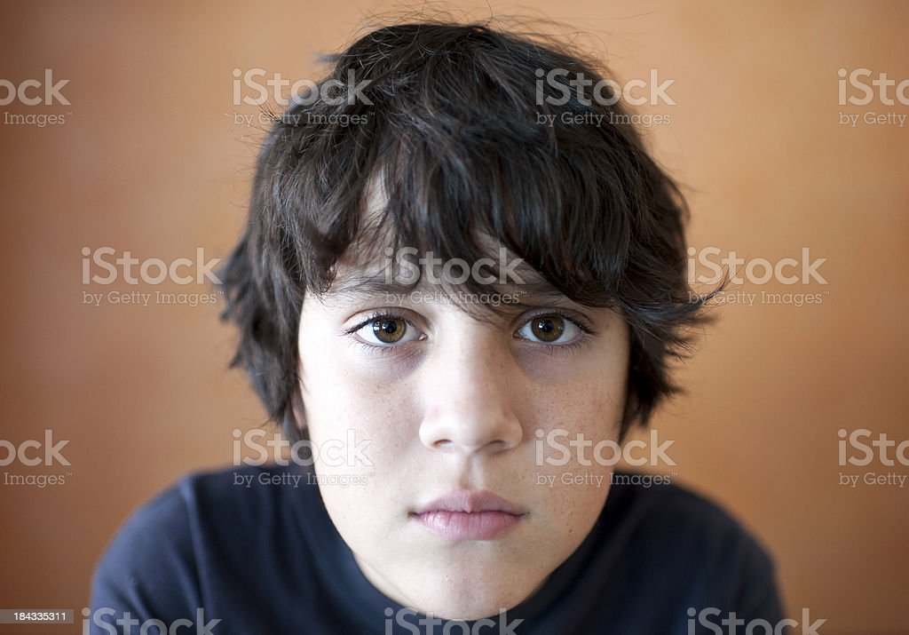 young boy looking at the camera stock photo