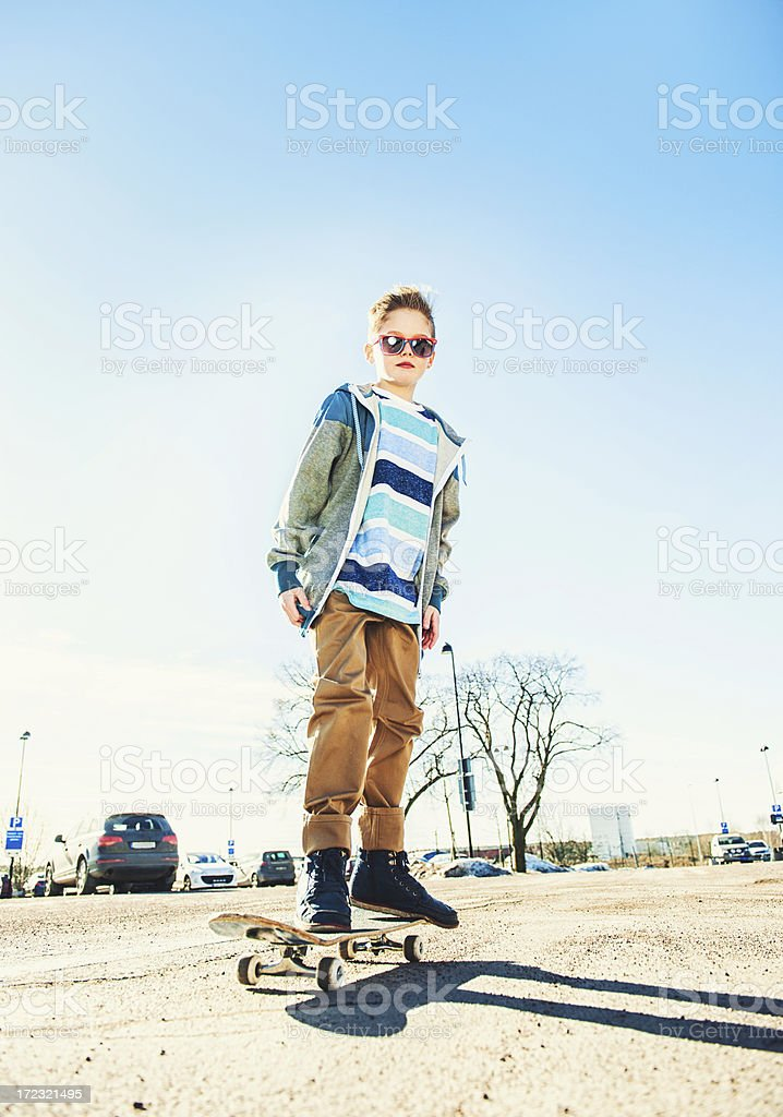 Young boy looking cool in skater clothing and cap royalty-free stock photo