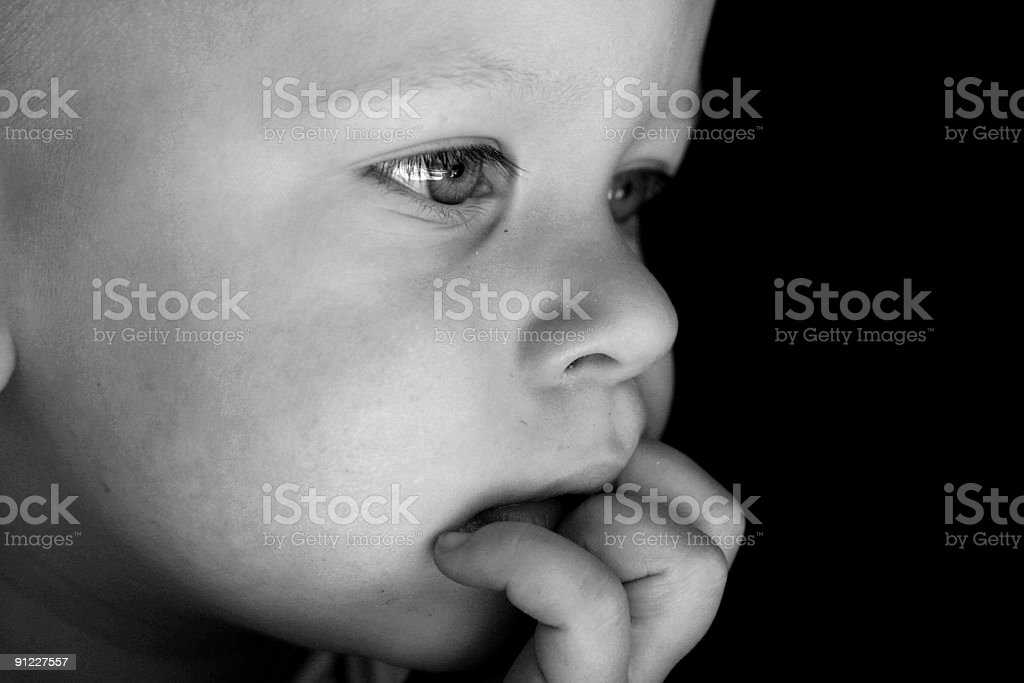 Young boy looking outside royalty-free stock photo
