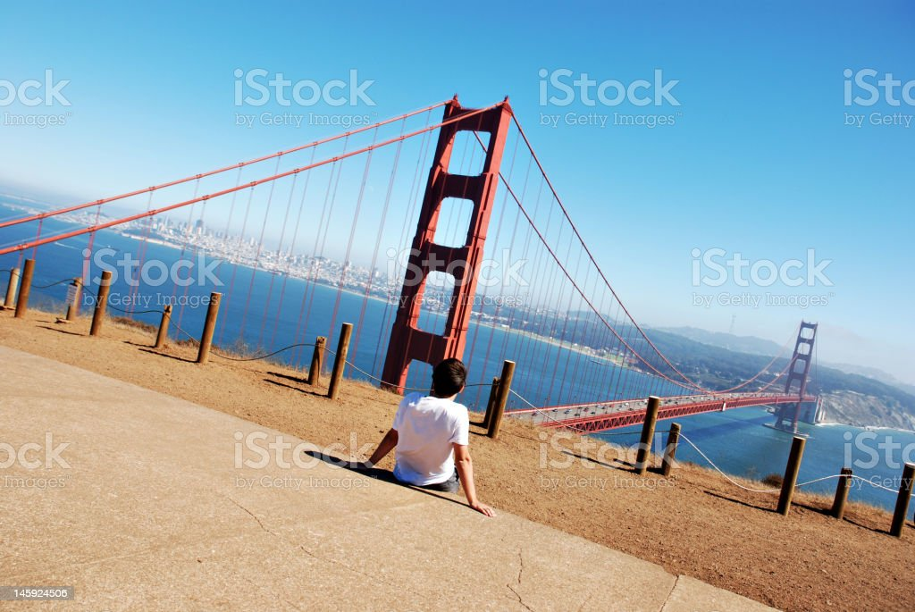 Young boy looks at the Golden Gate Bridge royalty-free stock photo