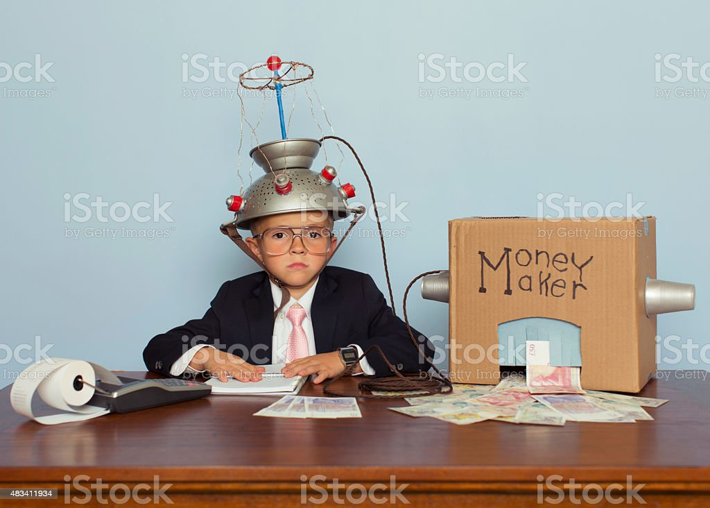 Young Boy Makes Money with Idea Helmet stock photo
