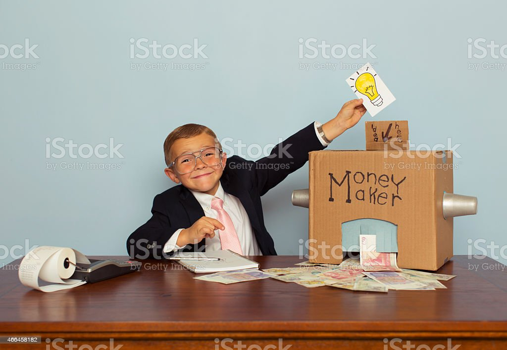 Young Boy Makes Money with Ideas stock photo
