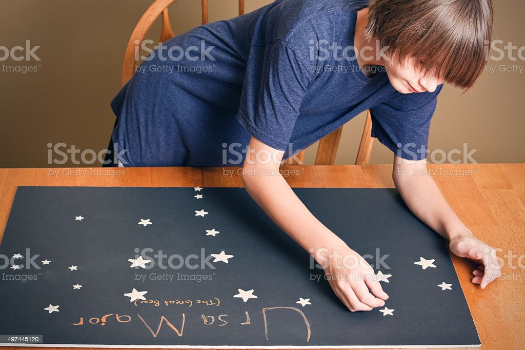 Young Boy Making Constellation Science Project stock photo