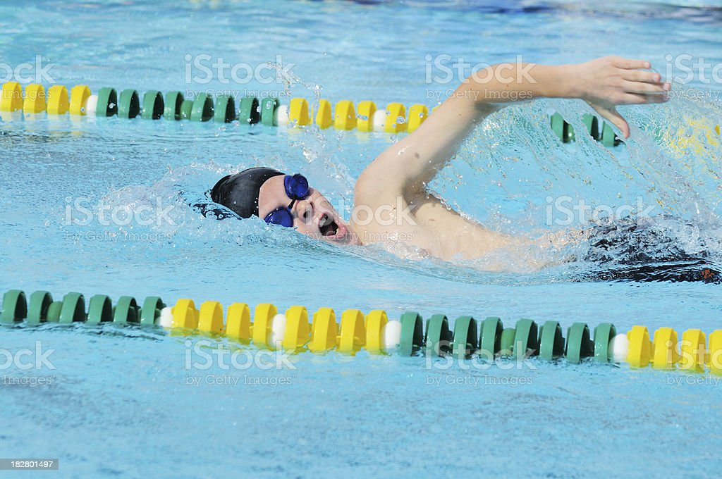 Young Boy Male Athlete Freestyle Stroke Swimming Racing in Pool stock photo