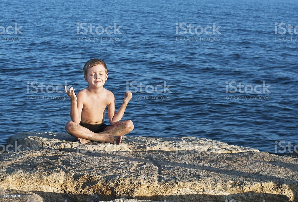 young boy meditating royalty-free stock photo