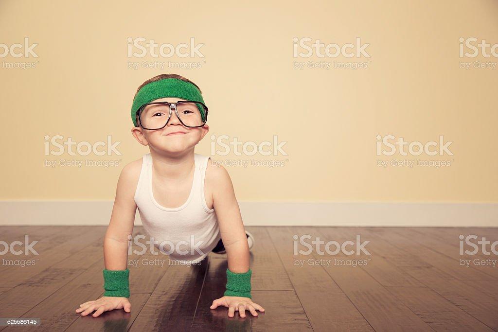 Young Boy Nerd doing Pushups in Studio stock photo