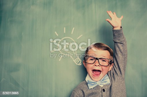 istock Young Boy Nerd Has an Idea in Classroom 526313665