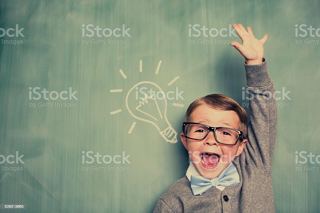 Young Boy Nerd Has an Idea in Classroom stock photo